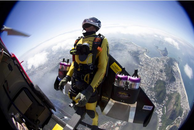 Yves Rossy, known as the Jetman, jumps from a helicopter before a successful flight over Rio de Janiero