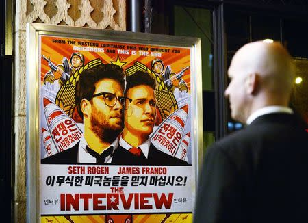 "File photo of a security guard standing at the entrance of United Artists theater during the premiere of the film ""The Interview"" in Los..."
