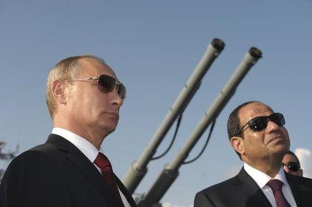 Russia's President Putin and his Egyptian counterpart Sisi attend a welcoming ceremony onboard guided missile cruiser Moskva at Sochi