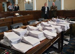 FILE - This May 15, 2013 file photo shows stacks of …