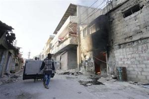 People loot furniture after soldiers loyal to Syria's…