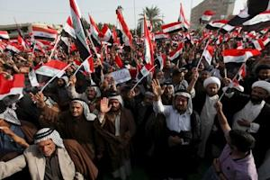 Supporters of prominent Iraqi Shi'ite cleric Moqtada…