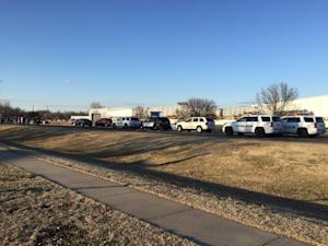 In this photo provided by KWCH-TV, police vehicles …