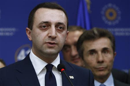 Georgia's Interior Minister Garibashvili speaks during a news conference as Prime Minister Ivanishvili looks on in Tbilisi