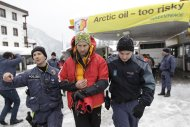 Swiss riot police arrest a Greenpeace protester at a Shell petrol station during the annual meeting of the World Economic Forum (WEF) in Davos-Wolfgang January 25, 2013. REUTERS/Denis Balibouse (SWITZERLAND - Tags: BUSINESS POLITICS CIVIL UNREST ENERGY ENVIRONMENT)