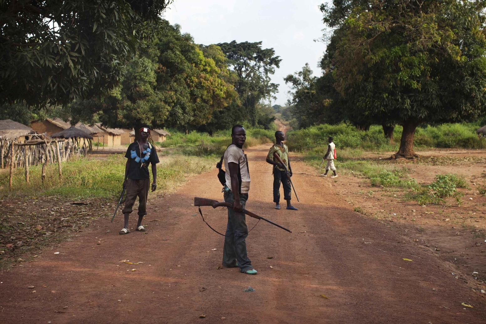 Militia fighters known as anti-balaka stand guard in Mbakate village