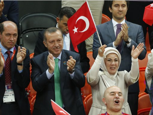 Turkey's Prime Minister Recep Tayyip Erdogan (2nd L)  and his wife Emine Erdogan attend the women's qualification game Olympic basketball match between Turkey and Angola during the London 2012 Olympic Games