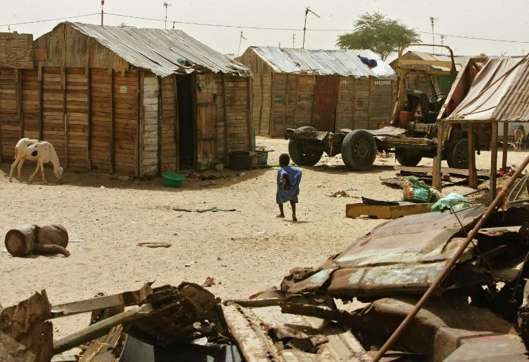 A Mauritanian boy walks towards his family's shack on March 7, 2007 in a shanty town in Nouakchott's El-Mina quarter, which is mainly inhabited by the descendants of ancient slaves
