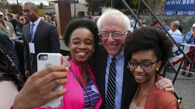 U.S. Democratic presidential candidate Bernie Sanders takes a selfie with supporters after a campaign rally at the South Carolina Democratic Party headquarters in Columbia