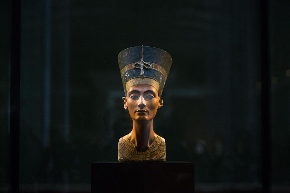FILE - In this Sept. 10, 2014 file photo, a 3,300-year-old bust of Queen Nefertiti stands on its socle, at the New Museum in Berlin, Germany. An...