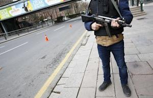 A police officer stands guard during a security control…