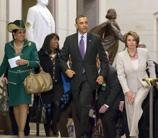 <p>               President Barack Obama and House Minority Leader Nancy Pelosi, D-Calif., leave a meeting with House Democrats at the Capitol, in Washington, Thursday, March 14, 2013. At far left is Rep. Frederica Wilson, D-Fla., with Rep. Terri Sewell, D-Ala., second from left. (AP Photo/J. Scott Applewhite)