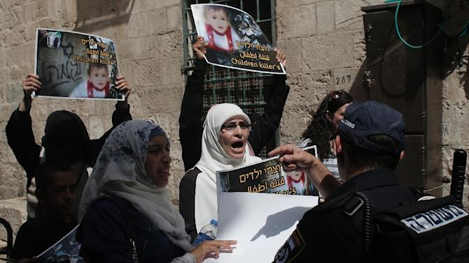 Israeli security forces block a road leading to the annexed east Jerusalem Al-Aqsa mosque compound on August 2, 2015 as Palestinians take part in a protest against the death of the 18-month-old child killed in an arson attack