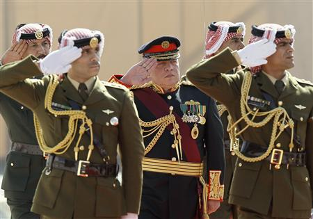 Jordan's King Abdullah (C) reviews an honour guard prior to the opening of the first session for the new parliament in Amman, February 10, 2013. REUTERS/Ali Jarekji