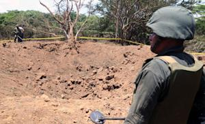 A Nicaraguan soldier checks the site where an alleged …