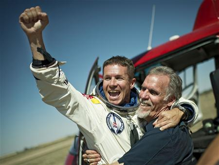 Handout photo of pilot Felix Baumgartner of Austria and Technical Project Director Art Thompson of the U.S. celebrating after Baumgartner successfully completed the final manned flight for Red Bull St