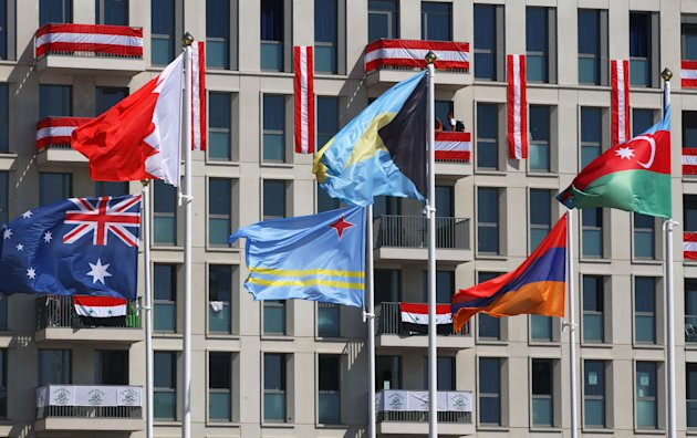 LONDON, ENGLAND - JULY 26: National flags fly at the Olympic Village arrivals ahead of the London 2012 Olympics at the Olympic Park on July 26, 2012 in London, England.  (Photo by Alexander Hassenstein/Getty Images)