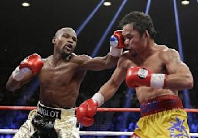 FILE - This May 2, 2015 file photo shows Floyd Mayweather…