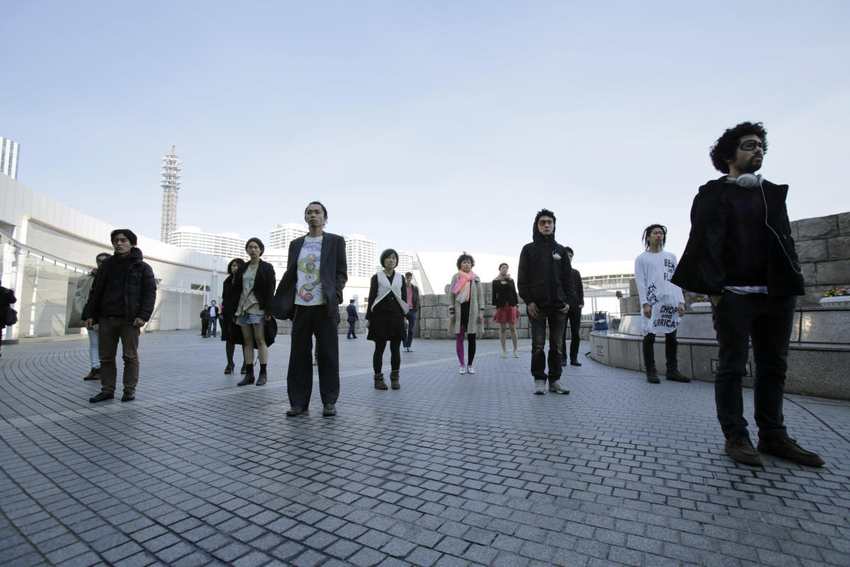 Demonstrators participate in a silence protest in front of a conference hall where the Intergovernmental Panel on Climate Change is meeting in Yokohama, near Tokyo, Monday, March 31, 2014. (AP Photo/Shizuo Kambayashi)