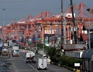 Cranes and container trucks are seen at the port of Manila on August 30. The Philippines said Thursday the economy grew a better-than-forecast 5.9 percent in the three months to June, largely due to a strong services sector. (AFP Photo/Ted Aljibe)