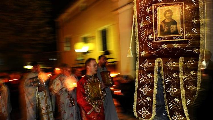 Macedonian Orthodox priests attend a midnight Easter service in the St. Dimitrija Church in Skopje on April 15, 2012