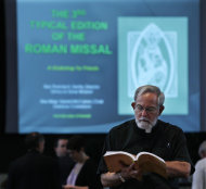 In this Oct. 24, 2011 photo, Monsignor Richard Arnhols of St. John the Evangelist Roman Catholic Church in Bergenfield, N.J., looks through a study guide for Catholic Mass, at St. Peter the Apostle Roman Catholic Church, in River Edge, N.J., during training sessions for priests of the Archdiocese of Newark, on the first new translation of the Mass liturgy in four decades. (AP Photo/Mel Evans)