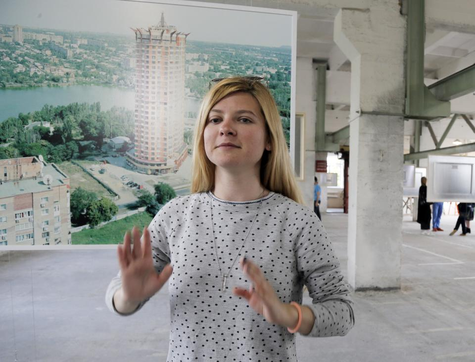 In this May 13, 2015, photo, Alesya Bolot gestures during an interview in Kiev, Ukraine. Bolot worked for a contemporary arts foundation that...