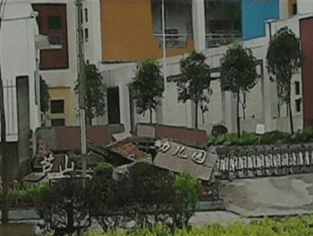 "A view of a collapsed building with a sign reading, ""Lushan Kindergarden"" after a 6.6 magnitude earthquake hit southwestern China's Sichuan province is seen in this April 20, 2013 still image taken from TV. REUTERS/China Central Television (CCTV) via REUTERS TV"