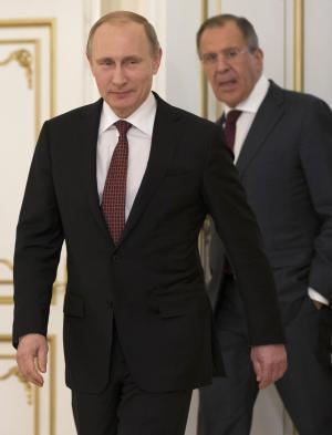 Russian President Vladimir Putin, foreground, and Russian…