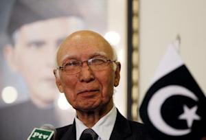 Advisor to Pakistan's Prime Minister on National Security and Foreign Affairs Sartaj Aziz listens to a question during a news conference with Iranian Foreign Minister Javad Zarif at the Foreign Ministry in Islamabad