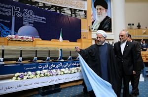 Iranian President Hassan Rouhani (L) and the Head of …
