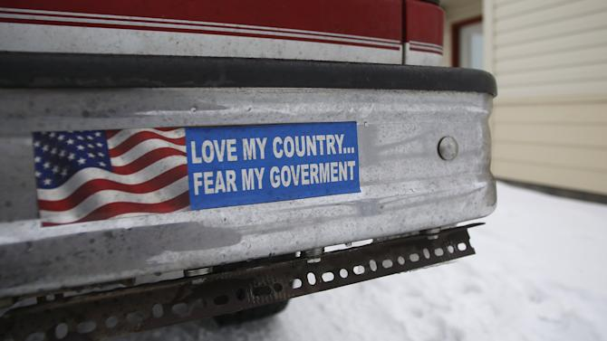 A bumper sticker on a private truck is seen in front of a residential building at the Malheur National Wildlife Refuge near Burns, Oregon