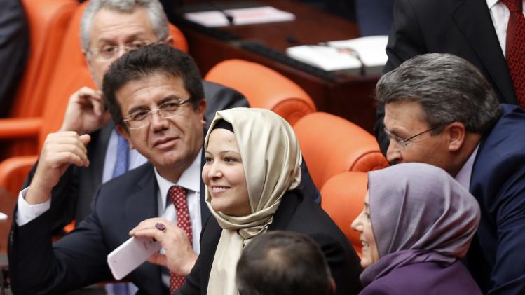 Turkey's ruling Ak Party lawmakers Nurcan Dalbudak and Sevde Beyazit Kacar attend the general assembly wearing their head scarves at the Turkish Parliament in Ankara