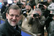 Spain's Prime Minister Mariano Rajoy returns after a short break at the EU council headquarters for an European Union leaders summit meeting to discuss the European Union's long-term budget in Brussels February 8, 2013. REUTERS/Eric Vidal