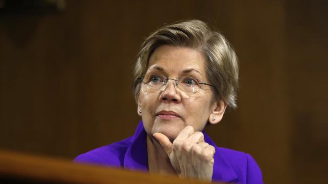 Warren listens to Yellen testify on Capitol Hill in Washington