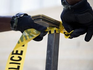 A US Park Police officer ties police tape to a hand …