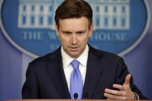 White House press secretary Josh Earnest gestures during …