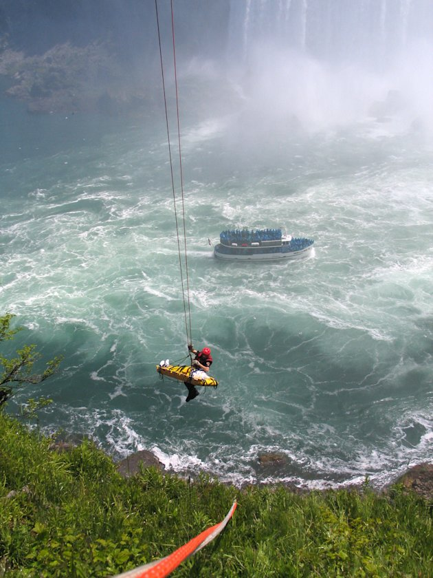 Niagara Falls emergency officials rescue a man who plunged over Niagara Falls and survived in an apparent suicide attempt, Monday, May 21, 2012. The man is only the third person known to have gone ove