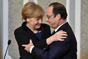 French President Francois Hollande, right, and German…