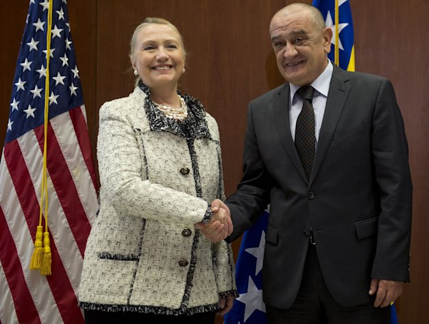 Bosnian Prime Minister Vjekoslav Bevanda, right, shakes hands with US Secretary of State Hillary Clinton, at the US Embassy in Sarajevo, Bosnia, Tuesday, Oct. 30, 2012. The top American and European diplomats are on a joint diplomatic tour of the Balkans, urging rival ethnic groups and governments in Bosnia, Serbia and Kosovo to settle their differences for the good of their nations. U.S. Secretary of State Hillary Rodham Clinton was talking Tuesday with European Union foreign policy chief Catherine Ashton in the Bosnian capital of Sarajevo. They are then meeting together with Bosnia's three presidents before travelling to Belgrade for similar talks with Serbian leaders. Clinton and Ashton will see Kosovo's leaders on Wednesday. (AP Photo/Saul Loeb, Pool)