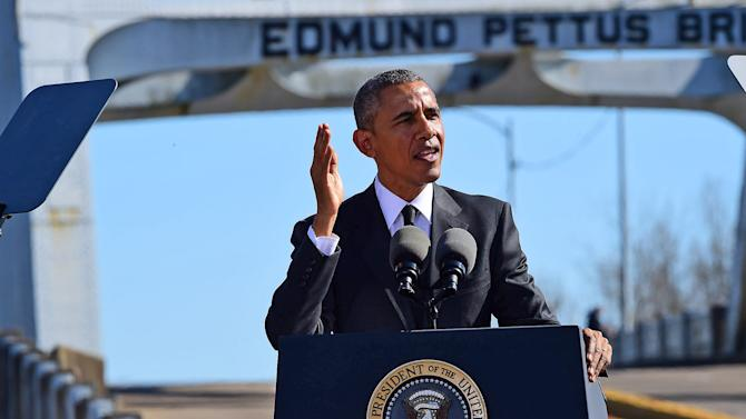 """President Barack Obama speaks near the Edmund Pettus Bridge, Saturday, March 7, 2015, in Selma, Ala. This weekend marks the 50th anniversary of """"Bloody Sunday,' a civil rights march in which protestors were beaten, trampled and tear-gassed by police at the Edmund Pettus Bridge, in Selma. (AP Photo/Bill Frakes)"""