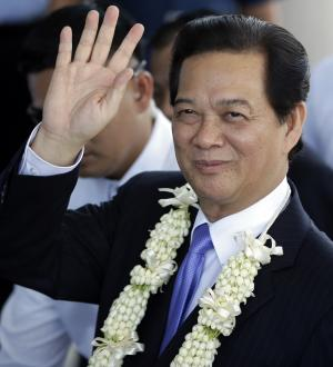 Vietnamese Prime Minister Nguyen Tan Dung waves to …