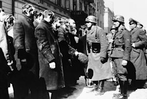 FILE - This 1943 file photo shows Nazi officers talking…