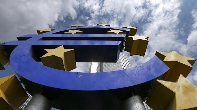A huge euro logo is pictured past next to headquarters of ECB in Frankfurt