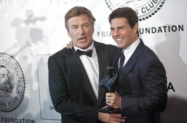 Actors Alec Baldwin and Tom Cruise pose with Cruise's Entertainment Icon Award before being presented with it in New York