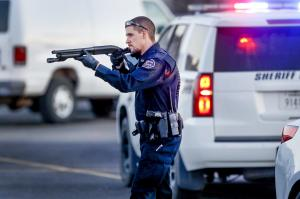 Police go through the parking lot of Excel Industries…