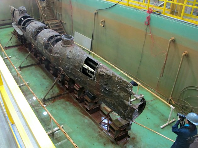 FILE - The Confederate submarine H.L. Hunley sits in a conservation tank after a steel truss that had surrounded it was removed in this Jan. 12, 2012 file photo taken at a conservation lab in North Charleston, S.C. Scientists say a pole on the front of the Confederate submarine H.L. Hunley designed to plant explosives on enemy ships may hold a key clue to its sinking during the Civil War. The experts are to release their findings Monday Jan. 28, 2013 at the North Charleston lab where the hand-cranked sub is being preserved and studied. (AP Photo/Bruce Smith, File)