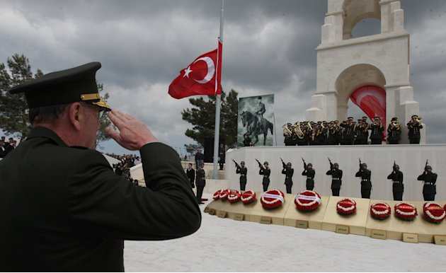 A Turkish army commander salutes with soldiers at the Turkish 57th Regiment Memorial in Gallipoli, Turkey, Monday, April 25, 2011. The World War I battlefield of the Gallipoli campaign, where throngs