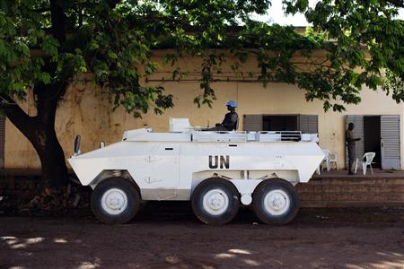 A UN peacekeeper from Senegal sits in an armored vehicle during patrol in Bamako