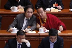 Gyaltsen Norbu, the 11th Panchen Lama, speaks with a delegate ahead of the opening of the third plenary meeting of Chinese People's Political Consultative Conference in Beijing
